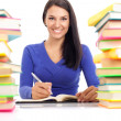 Smiling student wit lot of books — Stockfoto