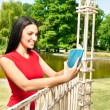 Teenager girl with book in park — Stock Photo #6628924