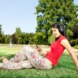 Girl with mp3 in park — Stock Photo #6628946