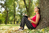 Writing in park — Stock Photo