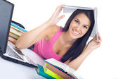 Student girl with book on head — Stockfoto