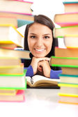 Student girl between stack of books — Stock Photo