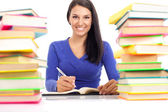 Smiling student wit lot of books — Stock Photo