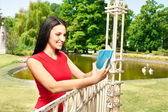 Teenager girl with book in park — Stock Photo