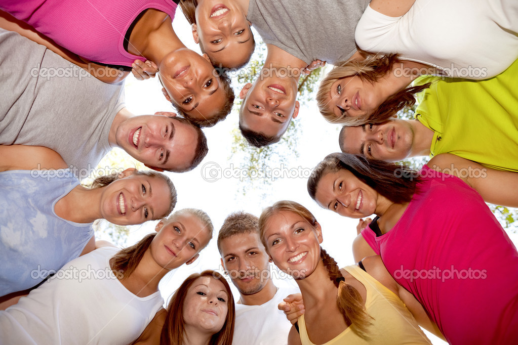 group of happy friends smiling with heads together  Stock Photo #6628383