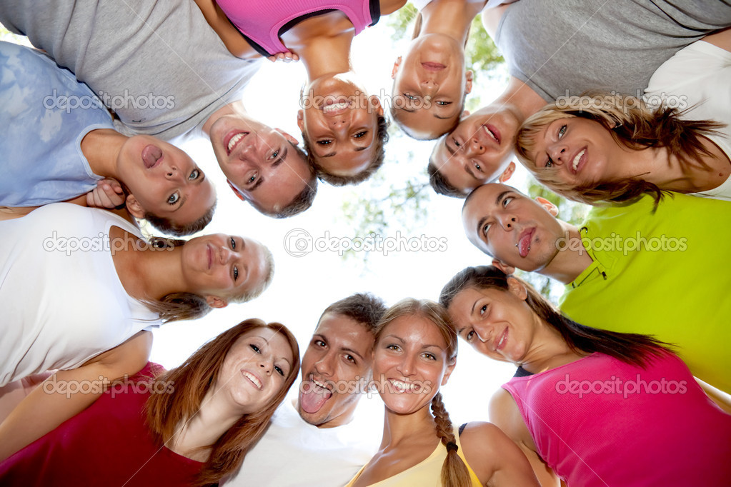 Friends happy group in circle heads together with crazy face  Stock Photo #6628402