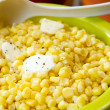 Sweet Corn with Melted Butter and Cracked Pepper - Stock Photo