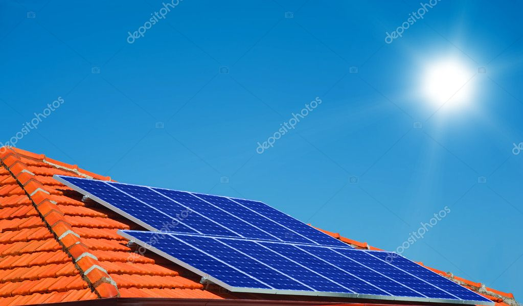 Solar panels on the roof of modern house — Stock Photo #5992295