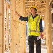 Young man at the construction site — Stock Photo