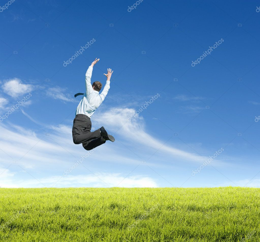 Happy young man jumping on meadow against clear sky background  Stock Photo #6438942