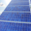 Solar panels sun and sky vertical — Stock Photo
