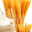 Bag with a flour and macaroni - Stock Photo
