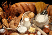 Bread, flour, milk, butter, eggs — Stock Photo