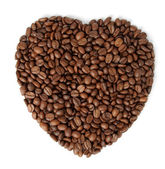 The fried grains of coffee in the form of heart — Stock Photo