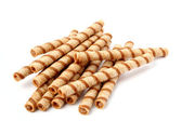 Heap of striped wafer tubules with the chocolate cream, isolated — Stock Photo