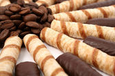 Chocolate sticks with a cream and the grains of coffee — Stock Photo
