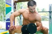 Bodybuilder and gym — Stock Photo