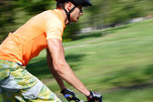 Bicyclist afoot — Stock Photo