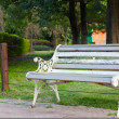Bench by park in an arboretum — Stock Photo