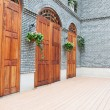 Traditional Chinese  house with wooden arch doors and deck. — Stock Photo