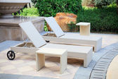 Lounge chairs in the garden — Stock Photo