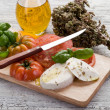 Mozzarella with oregano and tomato - Stock Photo