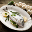 Gilthead over dish ready to cooking — Stock Photo #6387488