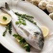 Gilthead over dish ready to cooking — Stock Photo