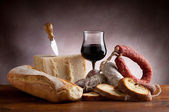 Parmesan cheese salami bead and wine — Stock Photo