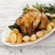 Chicken  with potatoes-pollo arrosto e patate - Stockfoto