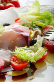 Swordfish carpaccio with sliced tomatoes — Stock Photo