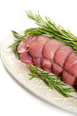 Raw veal rolled up — Stock Photo