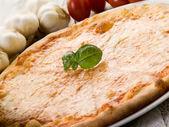 Pizza with buffalo mozzarella — Stock Photo