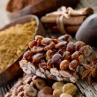 Hazelnut brittle on wood with ingredients — Stock Photo