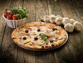 Pizza capricciosa — Stock Photo