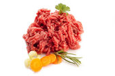 Grinded meat with ingredients — Stock Photo