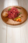Raw grinded meat with ingredients — Stock Photo