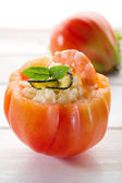 Open tomato with couscous shrimp and zucchinis — Stock Photo