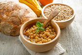 Chickpeas soup on wood bowl — Stock Photo