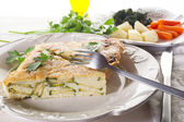 Omelette with zucchinis and parsley — Stock Photo