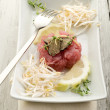 Tuna tartar with truffle and soy sprouts — Stock Photo