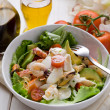 Mixed seafood salad with mozzarella and avocado - Stockfoto