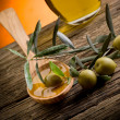 Olive oil over wood spoon — Stock Photo #6419252