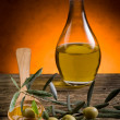 Olive oil over wood spoon — Stock Photo #6419418