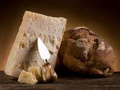 Parmesan cheese and bread - grana e pane rustico — Stock Photo