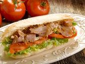 Kebab sandwich on dish — Stock Photo