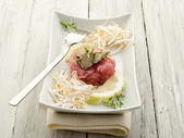 Tuna tartar with truffle and soy sprouts — Stok fotoğraf