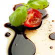 Olive oil balsmaic vinegar tomato and basil - Stock Photo