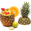 Sliced tropical fruits salad on pineapple — Stock Photo