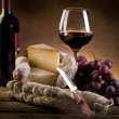 Cheese salami grapes and red wine — Stock Photo #6425429